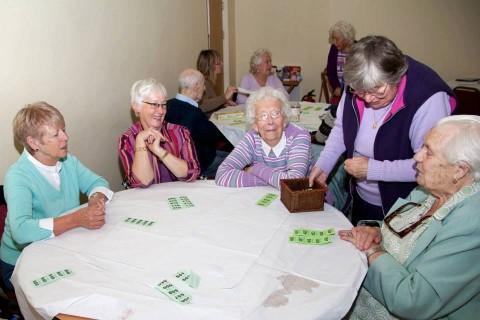 POPI projct lunch club volunteer selling raffle tickets